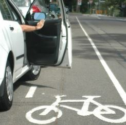 Car door opens as bicycle approaches